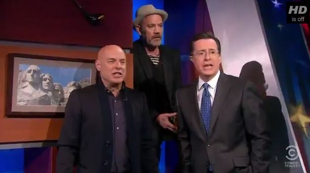 Video: R.E.M.'s Michael Stipe, Brian Eno and Stephen Colbert sing 'Lean on Me'