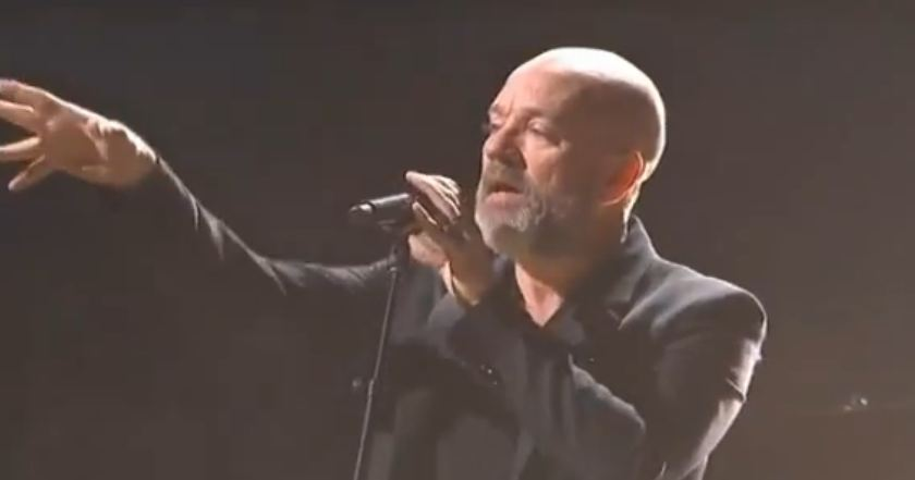 Video: R.E.M.'s Michael Stipe pops up at 12-12-12 concert, 'The Colbert Report'