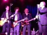 R.E.M. carefully avoids actual reunion as all 4 members play Peter Buck's wedding