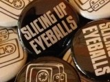 New at the merch table: Slicing Up Eyeballs' cassette-themed buttons — plus stickers