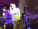 Watch The Charlatans' Tim Burgess, half of New Order jam acoustic in a church
