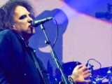 Robert Smith donating guitar played at The Cure's Pasadena Daydream festival to charity auction