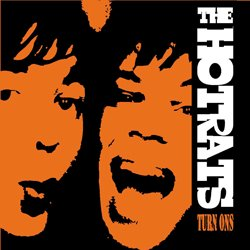 Video: Supergrass spinoff The Hot Rats plays The Cure's 'Lovecats' at Glastonbury