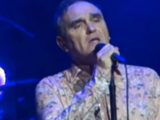 Morrissey refutes reports he was attacked by fan during show-ending stage invasion